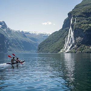 Fjord kayaking in Geirangerfjord. Seven sister waterfall in the front. We are using super stable and safe kayaks that suits all levels. Guided tours or rental.