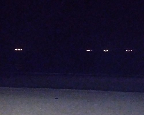 Sandown beach at night. The lights are the ships anchored for the night.