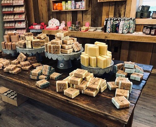 Much of the product, like the soap bars on this table, are created in the store.
