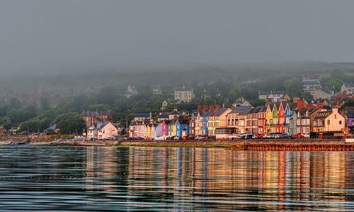 Sea mist can't dampen the colourful village of Whitehead in Antrim! 🤩🌈                                               📍 Whitehead, County Antrim                                                                                             📸 instagram.com/social_stephen/