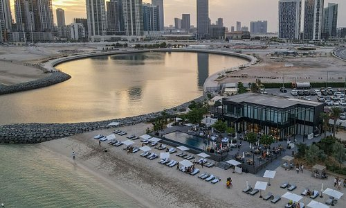 The time is now for a beach vacay! Here's a new address to chill out #InAbuDhabi 🏖️!  Cove Beach is the latest lifestyle destination with an amazing fun ambience and views of the picturesque ocean and the magnificent Al Reem skyline 🌊🏄♀️☀️🌴     #TheTimeIsNow #StaySafe #AbuDhabi