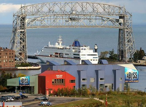 watched this ship leave the harbor; Great Lakes Aquarium in foreground
