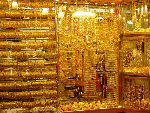 The gold boutiques display windows is lit up brilliantly to show off their gold-wear shades!