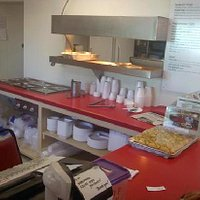 This here is the kitchen area of the restaurant where orders are taken, payments are made, and d
