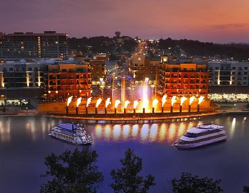 The Lake Queen and Lake Princess in front of Branson Landings spectacular fountain show.