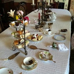 The dining room table set for afternoon tea.