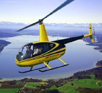 Helicopter over lake and bavarian alps