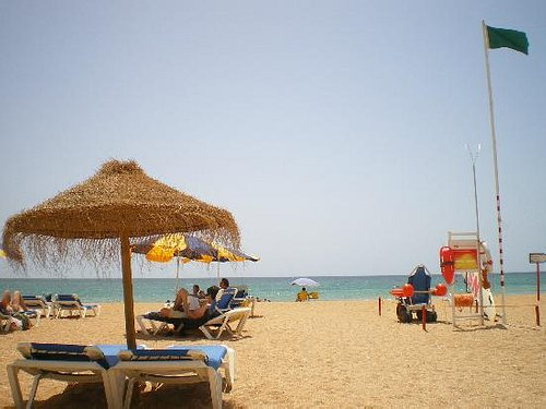 View of the beach from my sun lounger