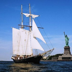 The Clipper City gliding by Lady Liberty