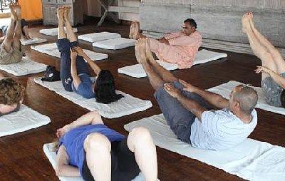 Guru Dhakal teaches a Yoga class at Shangri-La Village Resort in Pokhara