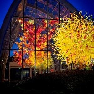 Glasshouse and Sun at night