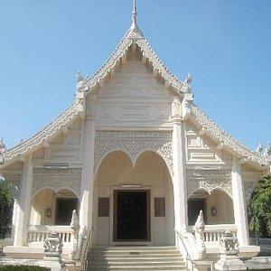 This lovely white viharn houses a Naga protected Buddha image