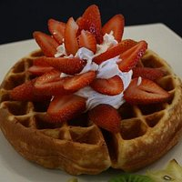 Waffle with fresh strawberries and whipped cream, kids favorite!