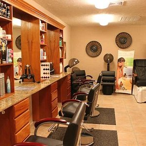 Beauty salon including manicures, pedicures, and hair treatment
