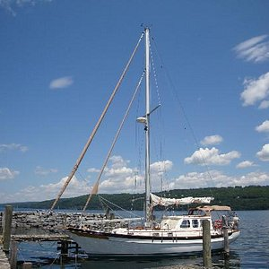 Sails down, parked in the harbor
