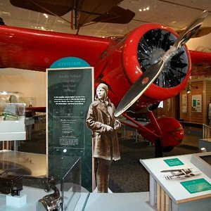 Amelia Earhart and Bessy her plane