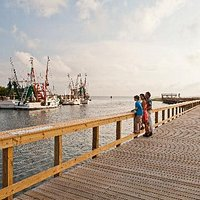 Watch the shrimping fleet some in with their local catch from the 10' boardwalk