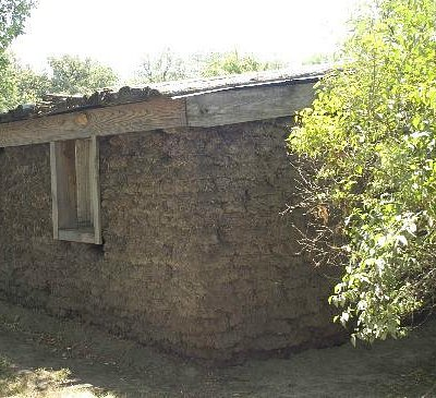 Not completely authentic .... outside walls are made of sod but have wood frame windows & roof