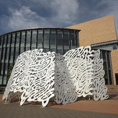 """Museum with """"Thread"""" sculpture in front"""