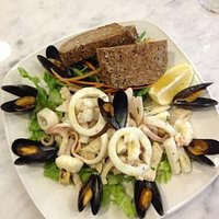 fresh mixed seafood salad served with brown bread