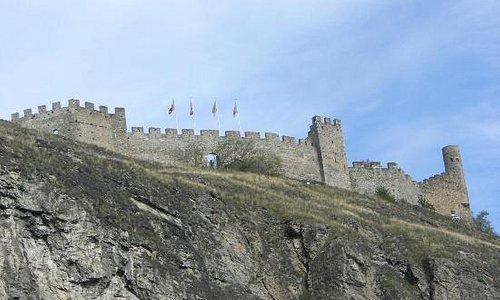 Flags flying on the Chateau (castle) de Tourbillon