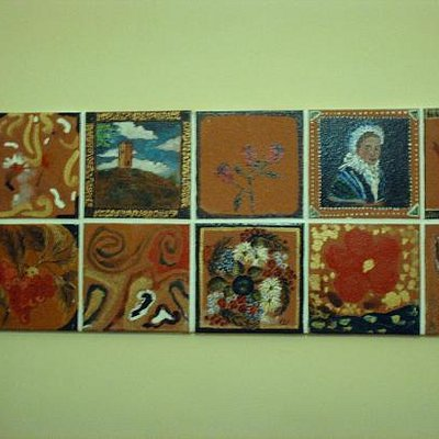 A display of tiles from a craft project at the museum