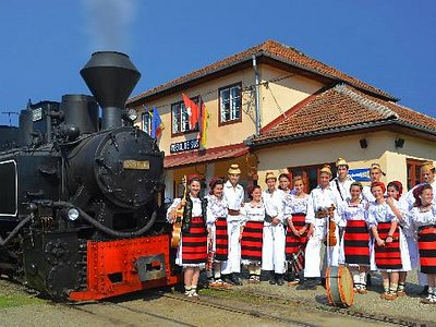 "The locomotive 764.421 ""Elveţia"" with a traditional group of children"