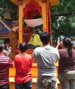 Locals praying during Songkran festival