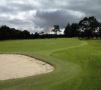 a view of the fairway with the volcanic action in the background