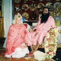 Enjoying a photo op at Sri Swamiji's feet. Such vibrant energy.