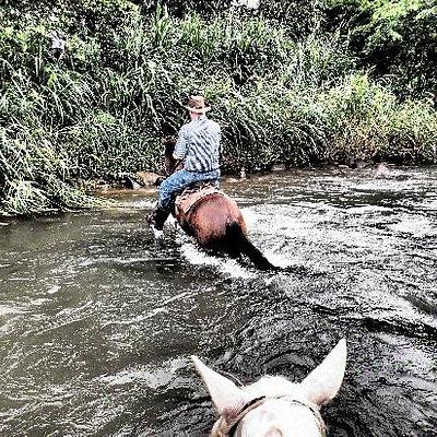 Crossing river on horseback