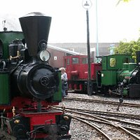 2 green locomotives