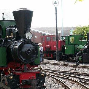 2 green locomotives