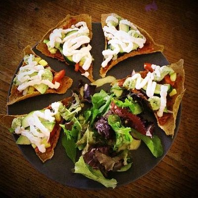 Raw Pizza with Mixed Greens