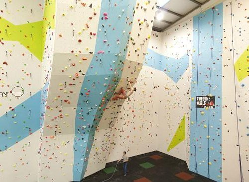 Climber on competition wall Awesome Walls Dublin
