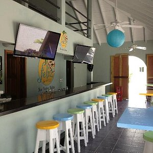 """One side of the bar with two of our 43"""" flat screens"""